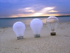 Blue sky marketing - light bulbs on a beach